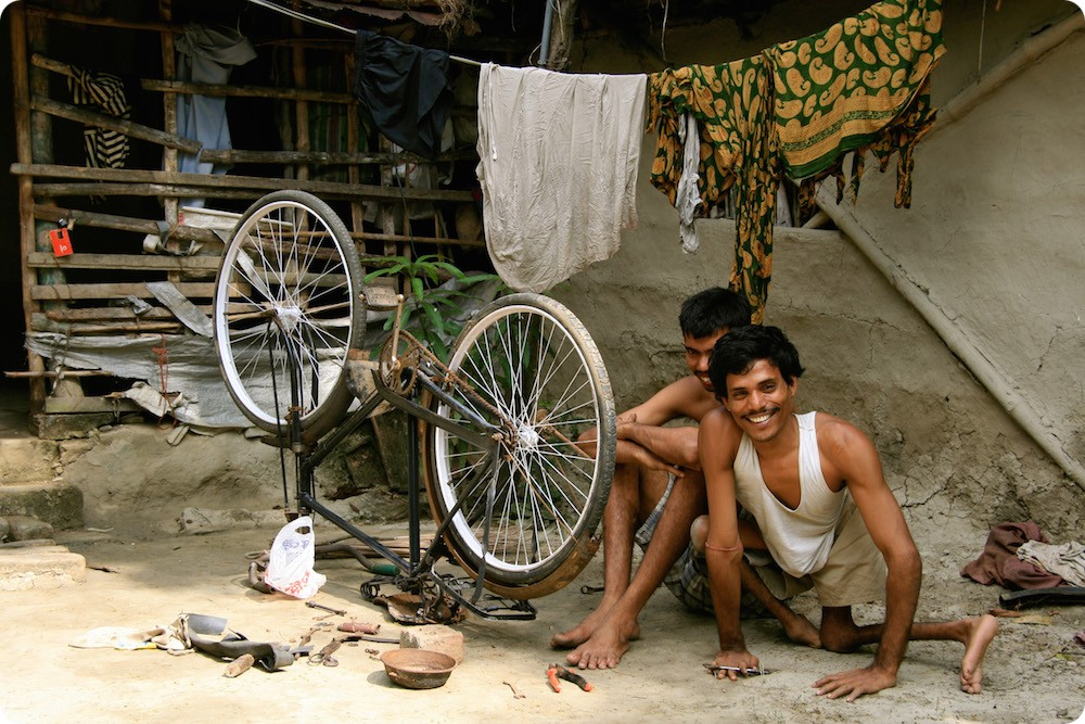 A social enterprise: a disabled man repairing a bicycle in Cambodia