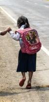School Girls Running On A Road In Cambodia
