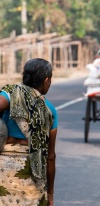 Women Carrying Water In A Jar, Walking On A Street In Cambodia